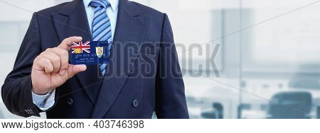 Cropped Image Of Businessman Holding Plastic Credit Card With Printed Flag Of Anguilla. Background B