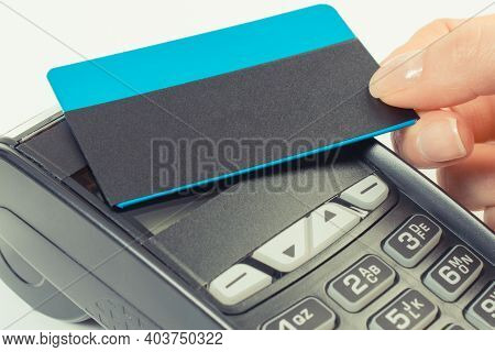 Hand Of Woman Using Credit Card Reader With Contactless Credit Card. For Cashless Paying For Differe