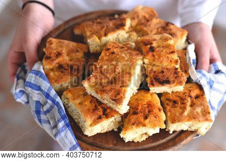Female Hands Holding Freshly Baked Bread/ Homemade Italian Focaccia With Rosemary And Olive Oil/ Fre