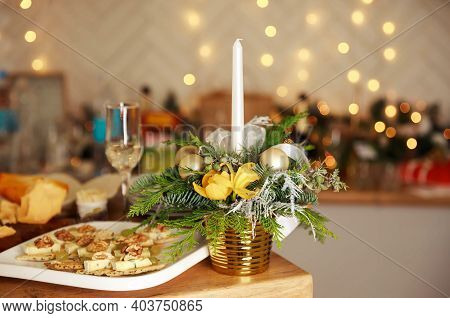 Stylish Table Setting With Burning Candles And Christmas Decorations. Luxury Romantic Candlelight Di