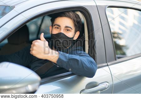 Portrait Of Young Man Driving His Car