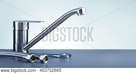 Plumbing Tools And Fittings On Grey Background With Copy Space. Plumbing Service Banner. Repair Conc