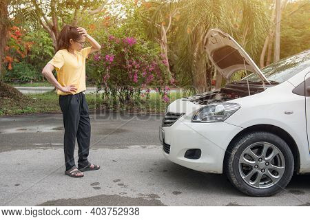 Young Stressed Woman Having Trouble With Her Car Breakdown On The Road And She Waiting Someone Can H