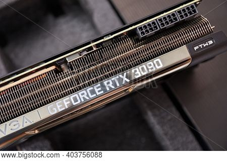 Budapest, Hungary - Circa 2020: Nvidia Geforce RTX 3090 Graphics Card by EVGA, Hardware detail, label on the heatsink, FTW3 Ultra, powerful piece of hardware also suitable for cryptocurrency mining