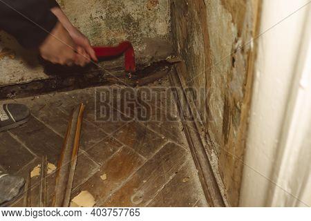 Dismantling The Floor Parquet Loft Retro Construction Work Crowbar Hammer
