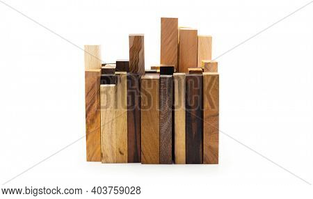 Construction. Blocks of various exotic woods standing up in a cluster. Isolated on white.