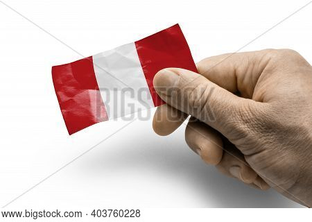 Hand Holding A Card With A National Flag The Peru