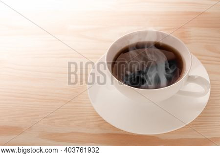 Coffee Cup On The Desk, Above Top View. Coffee Mug On Light Wooden Table. White Coffee Cup On Wooden