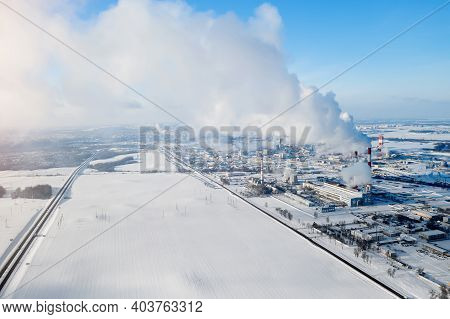 Huge Chemical Plant On The Background Of A Snow-covered Field Top View.