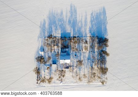 Lonely House In The Middle Of A Snow-covered Field Top View.