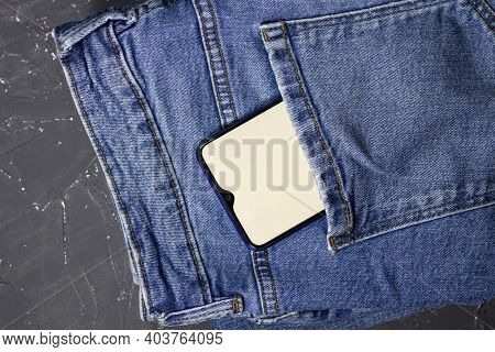 Modern Phone In Jeans Pocket Displaying Screen. Cash Dollars From Pocket , Back Pocket Of My Jeans M