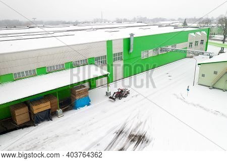 Tractor Cleaning Snow At The Factory Top View.