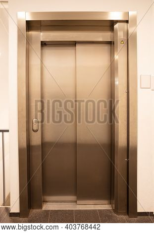 Modern Office Fragment, Shining Elevator Doors In A White Wall