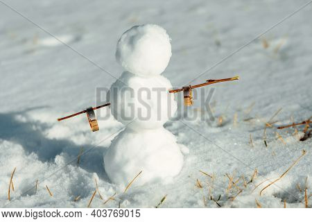 Snowman Holding Wedding Rings. Snowman Stands In The Snow. Winter Wedding Concept