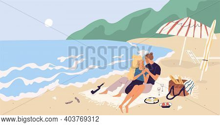 Young Couple Sitting And Relaxing On Picnic Blanket At Seaside. People Hugging And Drinking Wine On