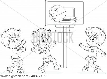 Cheerful Little Kids Playing Basketball With A Big Sports Ball On A Sportsground, Black And White Ou