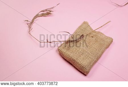 Dry Grass And Canvas Bag For Composition, On Pink Background, Diy Concept, Top View