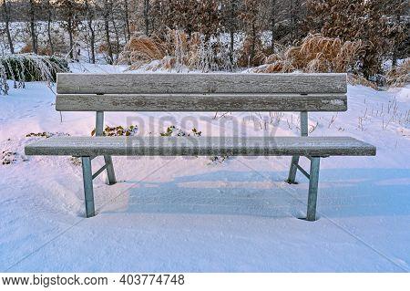 Frozen Empty Park Bench Standing In Kumla Park