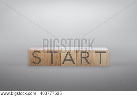 Start Word On Wooden Board With Color Background.