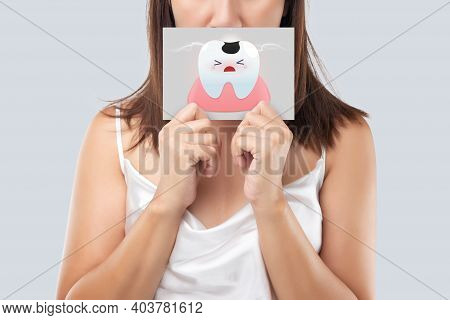 Asian Woman In The White Wear Holding A White Paper The Caries Cartoon Picture Of His Mouth Against