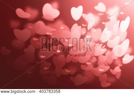 Valentine's Day. Background With Hearts. Hearts With Bokeh Effect Are Scattered On The Red Backgroun