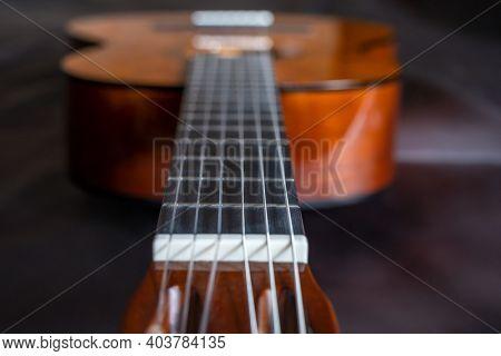 Beautiful acoustic guitar close-up, shallow DOF