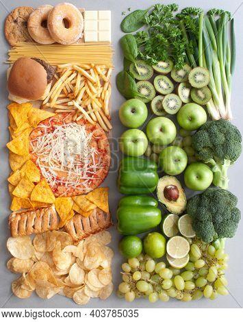 Assorted Group Of Green Fruits And Vegetables Alongside Beige Junk Food
