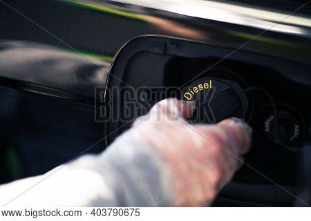 Automotive And Power Industry Theme. Men Wearing Plastic Gas Station Glove Filling Up Compact Car Di