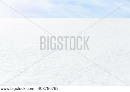 Fresh White Snow On A Blue Sky Background. Winter Frosty Landscape. Illuminated By The Side Sun. The