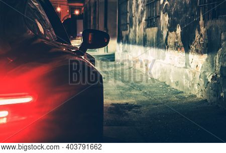Automotive Concept. Modern Luxury Car In The Dark City Alley During Late Night Hours. Vehicle Rear L