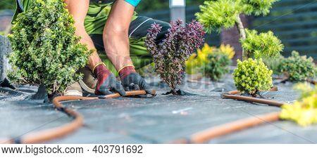 Landscaping And Gardening Industry. Modern Garden Irrigation System Building By Caucasian Garden Tec