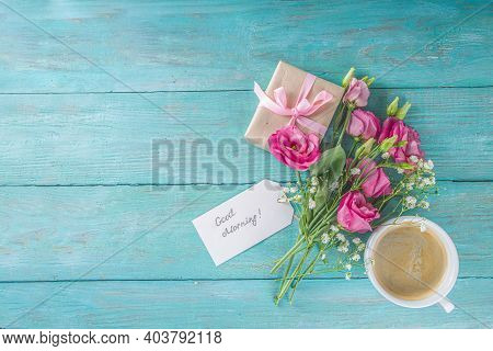 Bouquet Of Spring, Summer Flowers, Coffee Cup And Notes Good Morning, Have A Nice Day On Blue Wooden