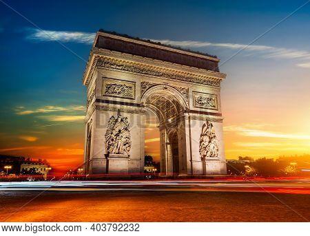 Arch Of Triumph In Paris At Sunny Sunrise, Long Exposure