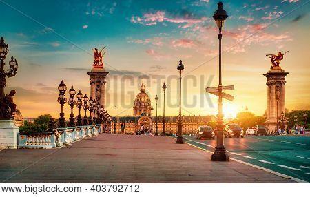 Les Invalides Quarter And Alexandre Iii Bridge In Paris At Sunset