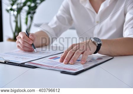 Financial Auditor Analyzing Financial Results. Paperwork And Trade Concept. Close Up