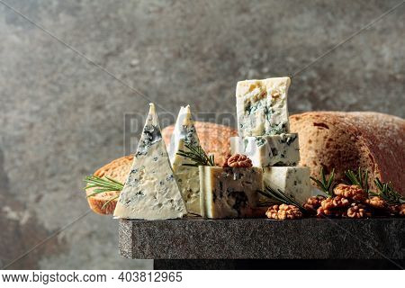Blue Cheese With Walnuts, Bread, And Rosemary. Copy Space.