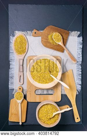 Bulgur, A Bunch Of Bulgur Next To The Village With A Spoon In Which Bulgur, On A Black Background. V