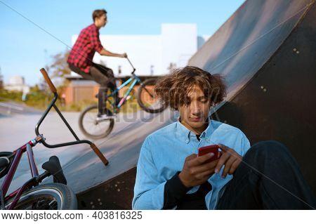 Bmx riders lifestyle, training in skatepark