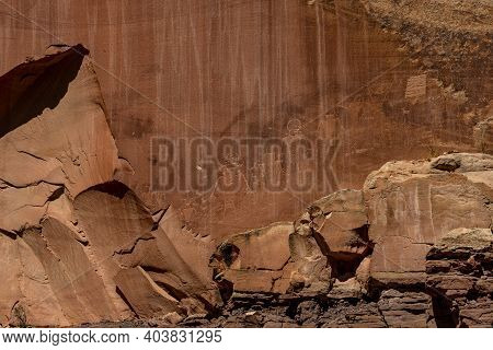 Line Of Petroglyphs On Sandstone Wall In Capitol Reef National Park