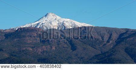Pico Del Teide Mountain Volcano In Snow, Bright Blue Sky. Teide National Park, Tenerife, Canary Isla