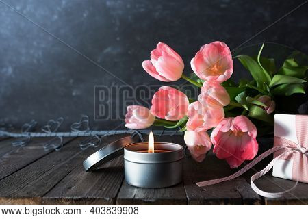Atmospheric Mothers Day Decoration With Bouquet Of Pink Tulips And Gift On Dark Vintage Wood. Space