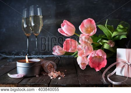 Atmospheric Mothers Day Decoration With Bouquet Of Pink Tulips And Gift On Dark Vintage Wood.