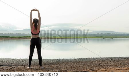 Lifestyle Woman Worm Up Raise Arm Before Pose For Healthy Life. Young People Yoga Exercise And Pose