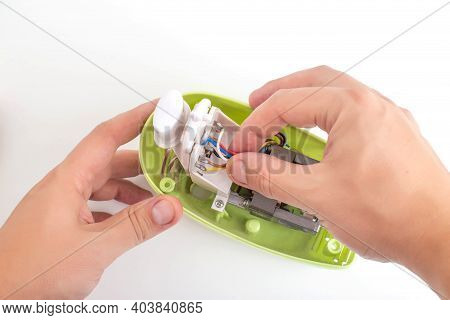 A Man Repairs A Broken Kitchen Mixer, Close-up. Concept For The Provision Of Services For The Repair