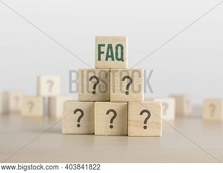 Faq, Q And A Or Problem Solving Concept. Wooden Blocks With Question Mark Icon Arrangedin Pyramid S
