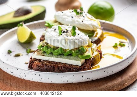 Healthy Breakfast With Wholemeal Bread Toast And Poached Egg Avocado And Microgreen For Healthy Brea