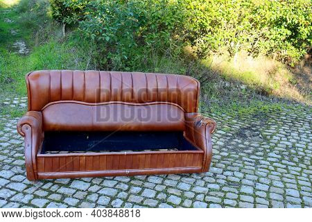 Old Brown Sofa. The Broken Sofa Is On The Street.