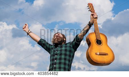 Sense Of Freedom. Bearded Man Play Acoustic Guitar. Casual Guy Express Human Emotions. Hipster With
