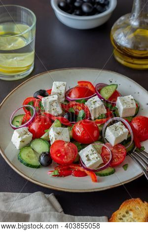 Greek Salad With Tomatoes, Cucumbers, Cheese, Onions, Peppers And Olives. Healthy Eating. Vegetarian