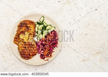 Healthy Paleo Food With Grilled Meat, Fresh Cucumber, Fermented Cabbage And Carrot
